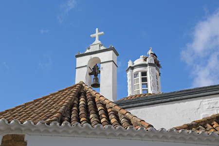 Top View of a church with stork birds in nest - Faro, Algarve, Portugal  photo