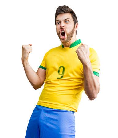 futball: Brazilian fan celebrates on white background Stock Photo