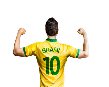 Brazilian fan celebrates on white background Stock Photo