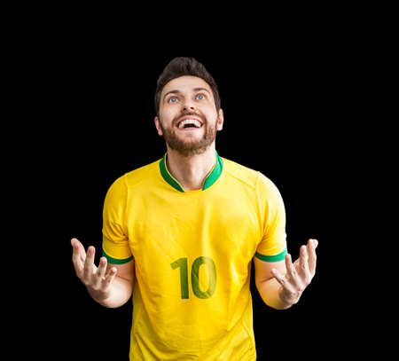 Brazilian fan celebrates on black background