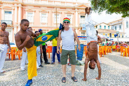 brazilian ethnicity: A group of people playing Capoeira