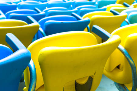 seating: Colored Seating rows in a Maracana stadium with weathered chairs, Rio de Janeiro, Brazil - Latin America
