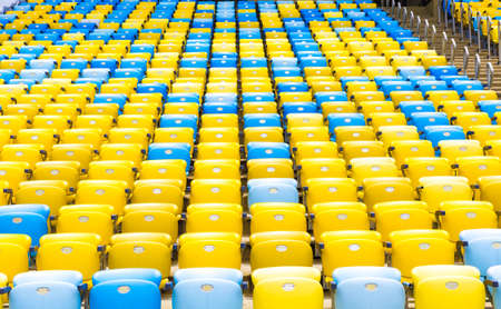 latin america: Colored Seating rows in a Maracana stadium with weathered chairs, Rio de Janeiro, Brazil - Latin America