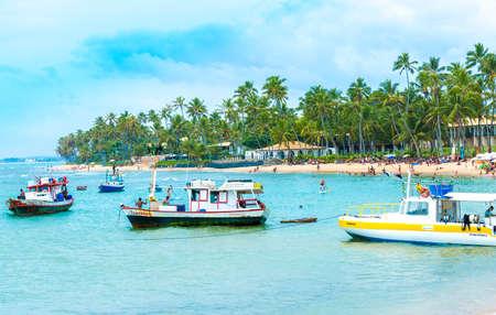 forte: BAHIA, BRAZIL - CIRCA NOV 2014: Boats at Praia do Forte Forte Beach in Bahia, Brazil