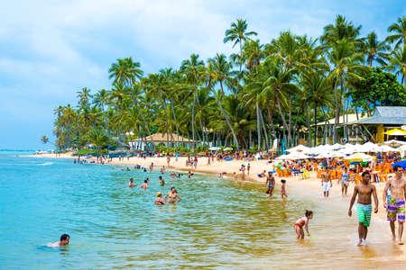 forte: BAHIA, BRAZIL - CIRCA NOV 2014: People enjoy a sunny day at Praia do Forte Forte Beach in Bahia, Brazil Editorial