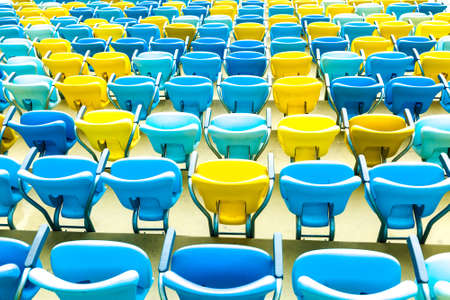 public sector: Colored Seating rows in a Maracana stadium with weathered chairs, Rio de Janeiro, Brazil - Latin America