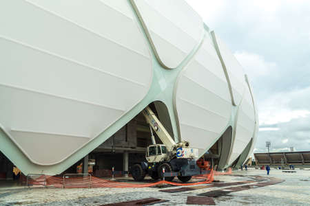 worldcup: Engineers construct the Arena Manaus in Manaus, Brazil