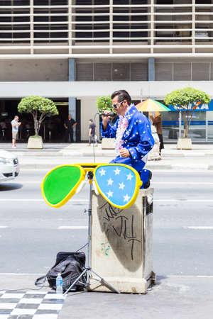 elvis presley: SAO PAULO, BRAZIL - CIRCA JAN 14 - Elvis Presley cover performes on Paulista Avenue in Sao Paulo, Brazil