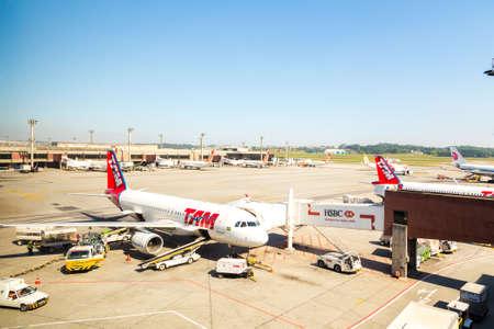 tam: SAO PAULO, BRAZIL - NOV 16: TAM Airplane in Guarulhos Airport on November 16, 2013 in Sao Paulo, Brazil Editorial