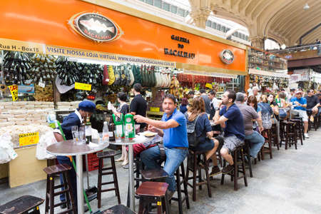 municipal: SAO PAULO, BRAZIL - CIRCA SEPTEMBER 2014: People eating at Municipal Market Mercado Municipal in Sao Paulo Editorial