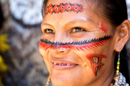 tribal woman: Native Brazilian woman smiling at an indigenous tribe in the Amazon