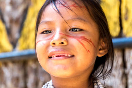 activate: activate Brazilian girl smiling at an indigenous tribe in the Amazon