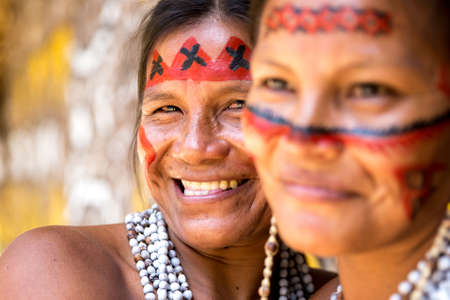 native american girl: Native Brazilian women smiling at an indigenous tribe in the Amazon