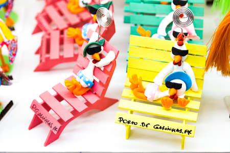 representing: Souvenirs representing the name of Porto de Galinhas with some Chickens Stock Photo