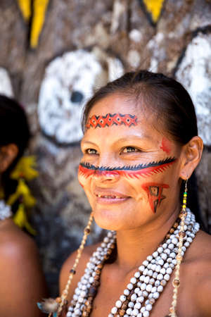 native american girl: Native Brazilian woman smiling at an indigenous tribe in the Amazon