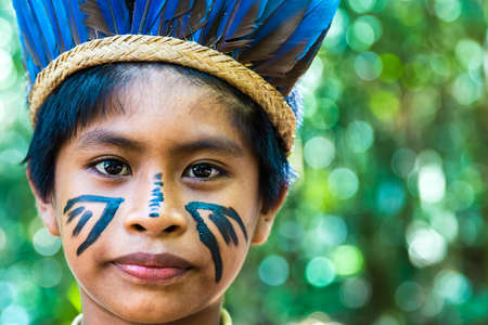 native american man: Native Brazilian boy at an indigenous tribe in the Amazon