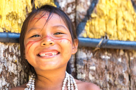 indigenous: Native Brazilian girl smiling at an indigenous tribe in the Amazon Stock Photo