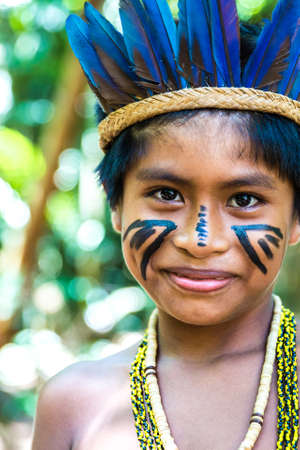 traditional culture: Native Brazilian boy at an indigenous tribe in the Amazon