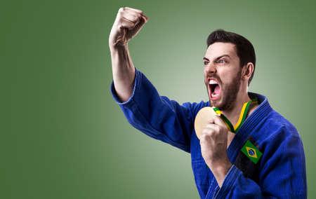 fighting styles: Brazilian judoka fighter on green background