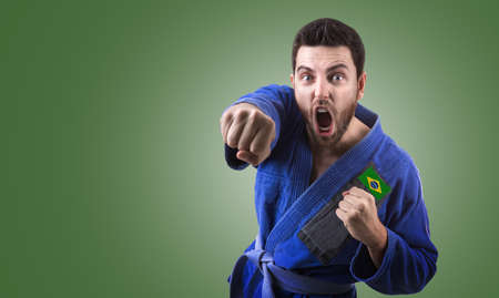 jiu jitsu: Brazilian judoka fighter on green background