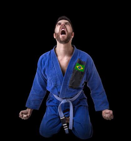 fighting styles: Brazilian judoka fighter isolated on black background Stock Photo