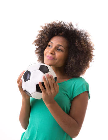 green and white: Brazilian woman playing with the soccer ball on white background Stock Photo
