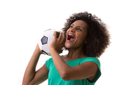 green' white: Brazilian woman playing with the soccer ball on white background Stock Photo