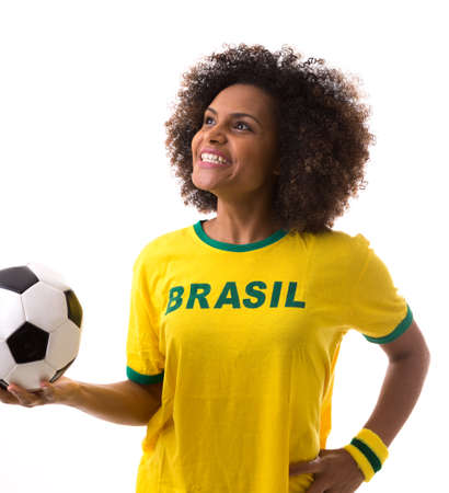 green and white: Brazilian woman celebrating on white background Stock Photo