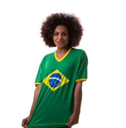 brazilian woman: Brazilian woman celebrating on white background Stock Photo