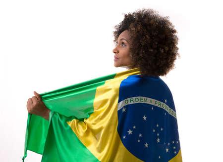 brazilian: Brazilian woman holding the brazilian flag Stock Photo