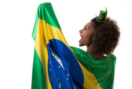 brazilian woman: Brazilian woman holding the brazilian flag Stock Photo
