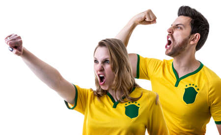 Brazilian couple fans celebrating on white background Stock Photo