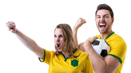 Brazilian couple fan celebrating on white background
