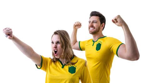 futball: Brazilian couple fans celebrating on white background Stock Photo