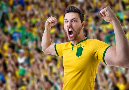 futball: Brazilian male fans celebrating in the stadium