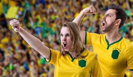 futball: Brazilian couple fans celebrating in the stadium