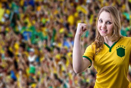 futball: Brazilian female fans celebrating in the stadium
