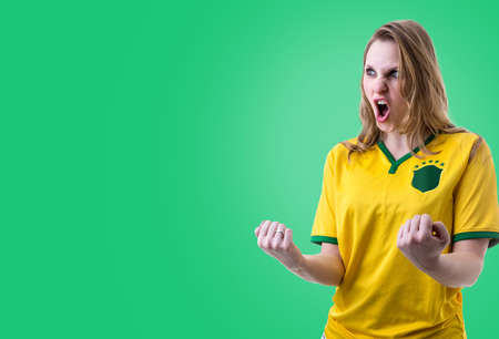 Brazilian female fans celebrating on green background
