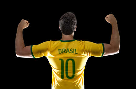 Brazilian male fan celebrating on black background Stock Photo