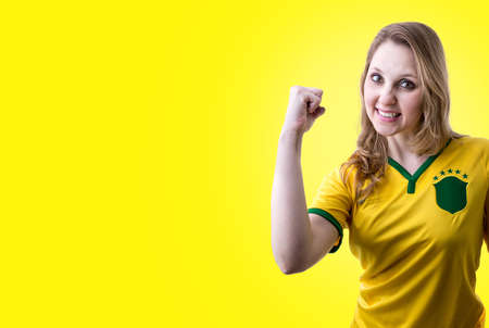 Brazilian female fans celebrating on yellow background