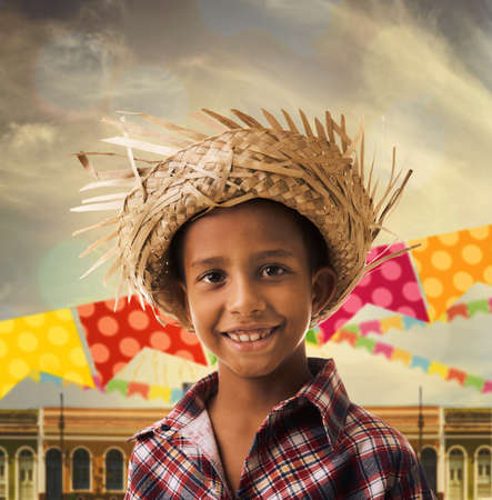 Boy wearing Caipira clothes for the Junina Brazilian Party Stock Photo