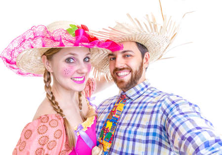 festa: Lovely Couple wearing Caipira clothes for the Brazilian Festa Junina