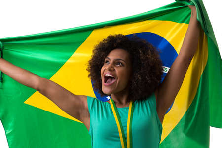 green and white: Brazilian woman holding the Brazilian flag on white background