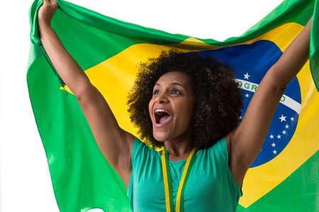 mulatto woman: Brazilian woman holding the Brazilian flag on white