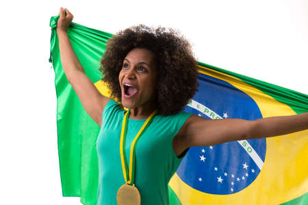 sport background: Brazilian woman holding the Brazilian flag on white