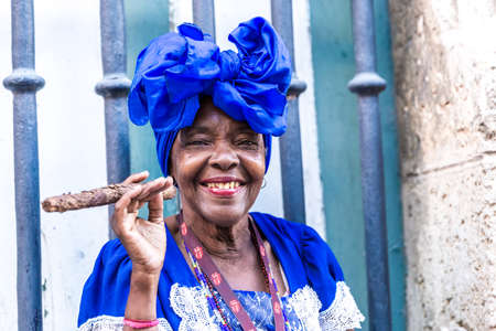 Woman smoking cigar in Havana, Cuba Stock Photo