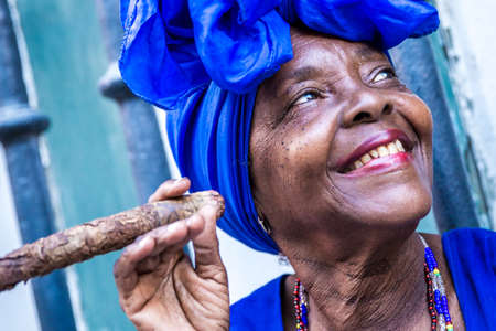 smoking a cigar: Woman smoking cigar in Havana, Cuba Stock Photo