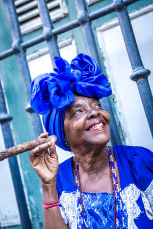 cigar smoking woman: Woman smoking cigar in Havana, Cuba Stock Photo