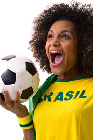 sport background: Brazilian woman holding a soccer ball on white background