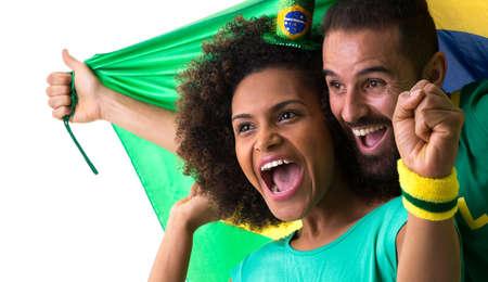 brazilian woman: Brazilian couple celebrating on white background Stock Photo